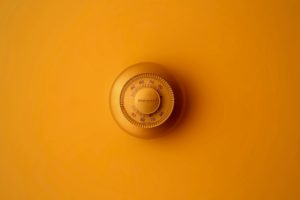 thermostat against orange wall
