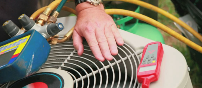 technician checking home AC unit